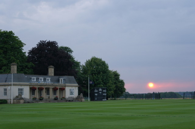 Sun setting Stowe Gardens cricket clubhouse