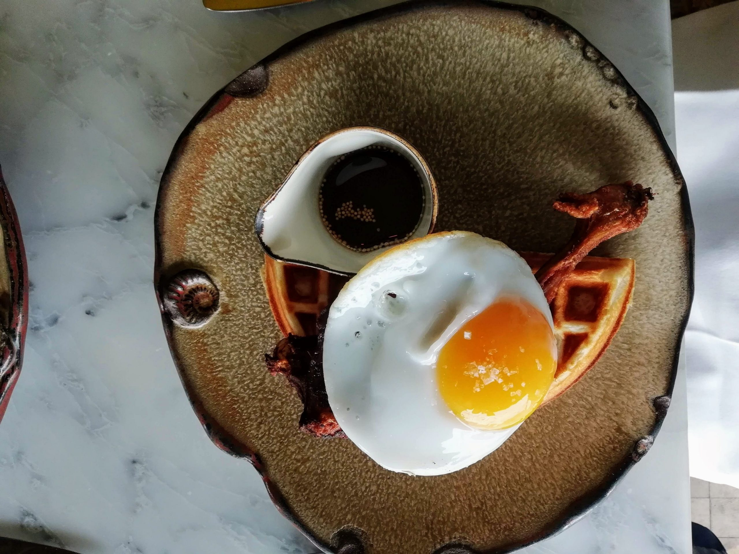 Duck and Waffle confit duck, fried duck egg and mustard maple syrup